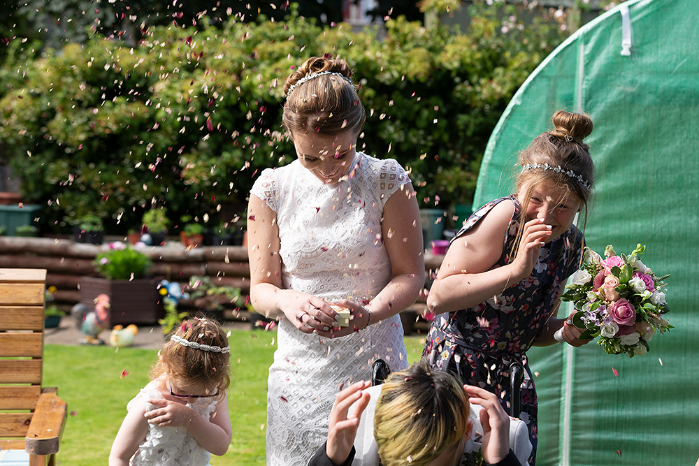 confetti being thrown over bride