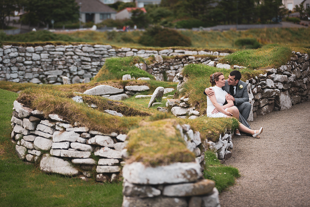 bride and groom relaxing at Clickimin Broch